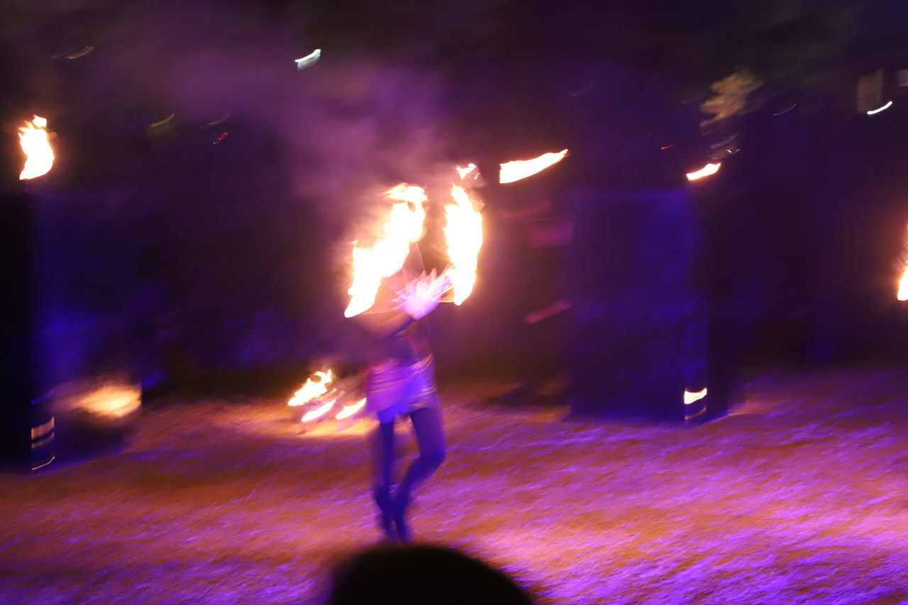 night, motion, real people, burning, flame, illuminated, fire, full length, arts culture and entertainment, blurred motion, one person, performance, fire - natural phenomenon, street, heat - temperature, glowing, lifestyles, city, skill, firework, sparkler, firework - man made object, light