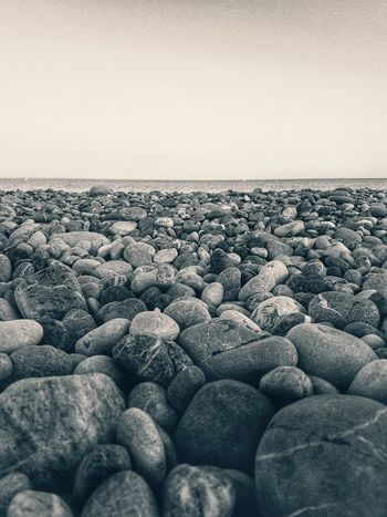 Blackandwhite Black And White Greece Stone Smartphonephotography Smartphone Photography Smartphone Samsung S7 Edge Photography EyeEm Ready   Sea Pebble Beach Outdoors Pebble Beach No People Nature Beauty In Nature Horizon Over Water Scenics Day Sky Clear Sky Close-up
