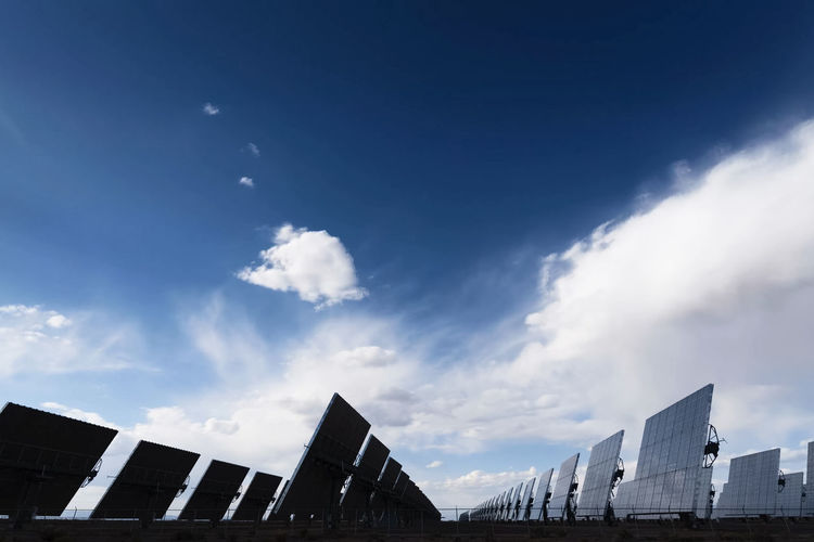 solar panels Sky Built Structure Architecture Cloud - Sky Building Exterior Nature Low Angle View Building Day No People City Outdoors Blue Sunlight Office Building Exterior Travel Destinations Industry White Color High Section Solar Panels