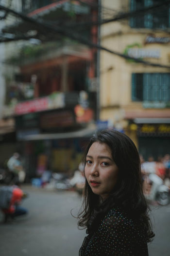 Architecture Building Exterior One Person Women Hair Built Structure Portrait City Focus On Foreground Real People Hairstyle Lifestyles Long Hair Street Headshot Leisure Activity Standing Females Casual Clothing Beautiful Woman Outdoors Contemplation