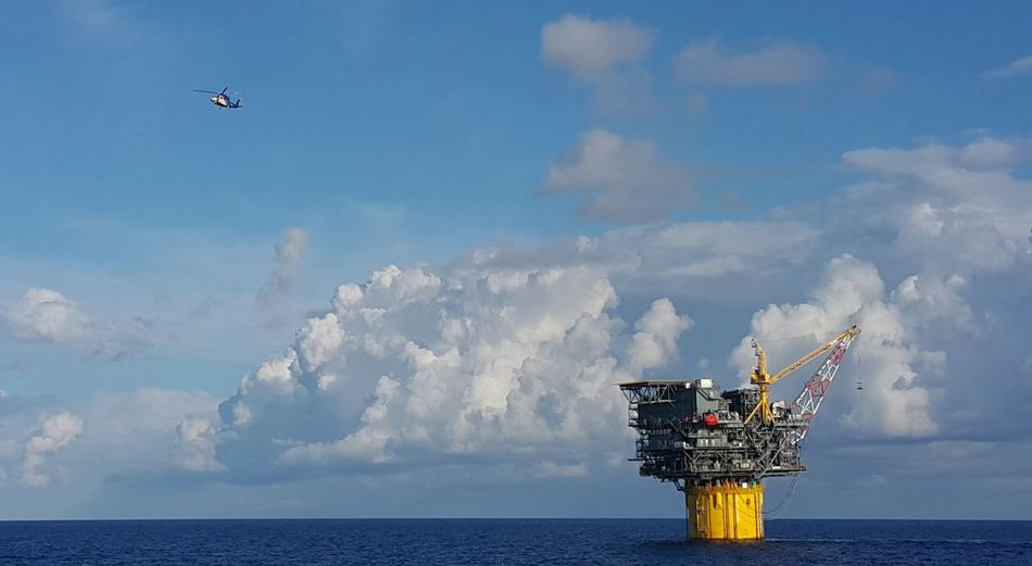 Helicopter leaving a Floating Production and Storage Spar during crew change date in Gulf of Mexico. FPSO Helicopter Airplane Built Structure Cloud - Sky Crew Change Day Drilling Rig Fp Fps Fuel And Power Generation Horizon Over Water Industry No People Offshore Platform Oil Industry Oil Pump Oilfield Oilfield Workers Outdoors Science Sea Sky Technology Water