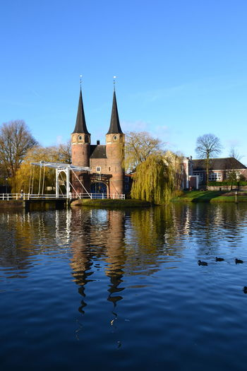 Delft Gate Netherlands Old-fashioned Reflection Architecture Blue Clear Sky Mirror Reflection Old Oostpoort Outdoors Reflection Sky Town Water Waterfront