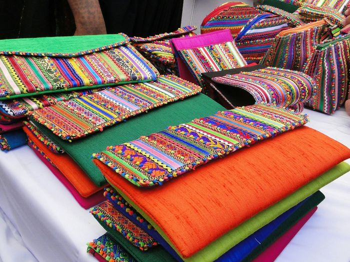 EyeEm Selects Wow I didn't know of this feature. This picture is from a stall at Kala Ghoda festival. The colourful clutches that the native Rajasthani lady was selling was picked up like hot cakes. Kalaghodaartfestival. Is a place where urban meets rural. The vibe is amazing. Awaiting for Feb 2018 to experience this energy again. Colorful Textile Market Multi Colored Retail  Colorsplash Color Explosion Colors Of Carnival Color Of Life Colored Background Stalls Kalaghoda Kalaghodafestival Stalls Urbanphotography Street Photography