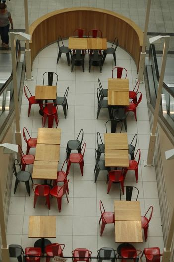 Empty chairs at tables. Chair Indoors  No People Day Seat Kingston Upon Thames England 🌹 Kingston Uk Pattern Backgrounds Shopping Mall Mall Square