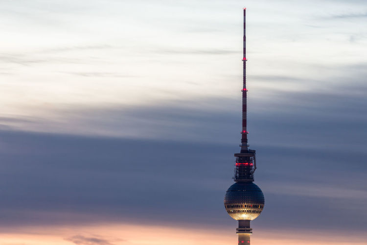 Fernsehturm Against Cloudy Sky During Sunset
