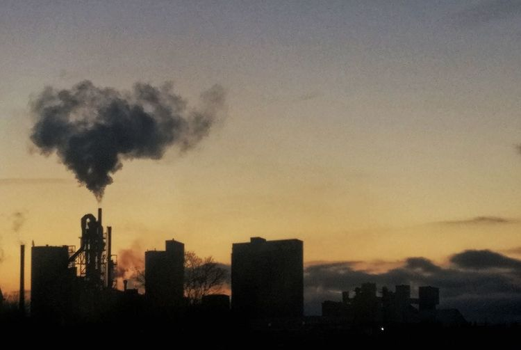 Air Pollution Architecture Building Exterior Built Structure Chimney City Cityscape Day Emitting Factory Fumes Industry Modern No People Outdoors Pollution Sky Skyscraper Smoke - Physical Structure Smoke Stack Sunset Tall