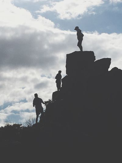 Silhouette Low Angle View Real People Sky Cloud - Sky Bird Outdoors Men Day Finding New Frontiers Sculpture Animals In The Wild One Person Statue People Clouds And Sky Darkness And Light Rock - Object In The Moment Togetherness Triumph Landscape Isolated Tranquility Wide Shot