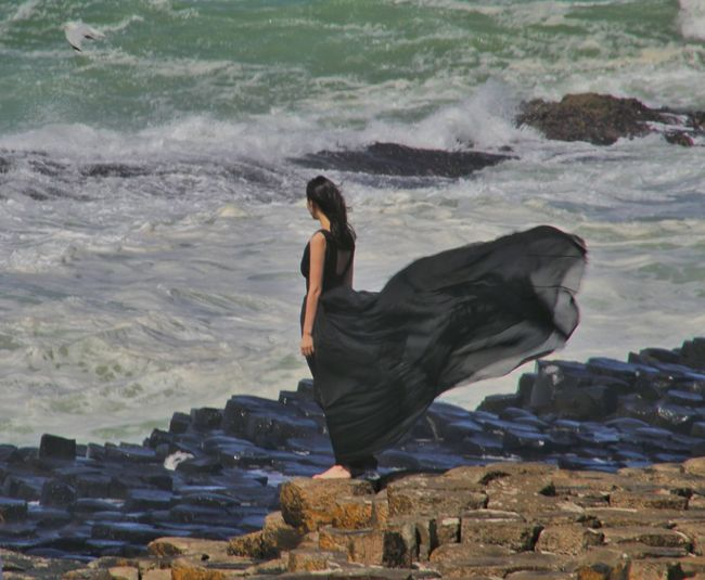 Giants Causeway Northern Ireland Best Of EyeEm Girl On The Rocks Windy Day EyeEm Gallery EyeEm Best Shots Exceptional Photographs Natures Magic Windy Black Dress Wind Blowing Girls Dress Girl In Black Dress Barefoot On The Rocks Atlantic Coast North Coast Of Ireland Waves And Rocks Our Best Pics Natural Phenomenon Strange Rock Formations Famous Landmarks World Heritage Rocks People People And Places Rethink Things