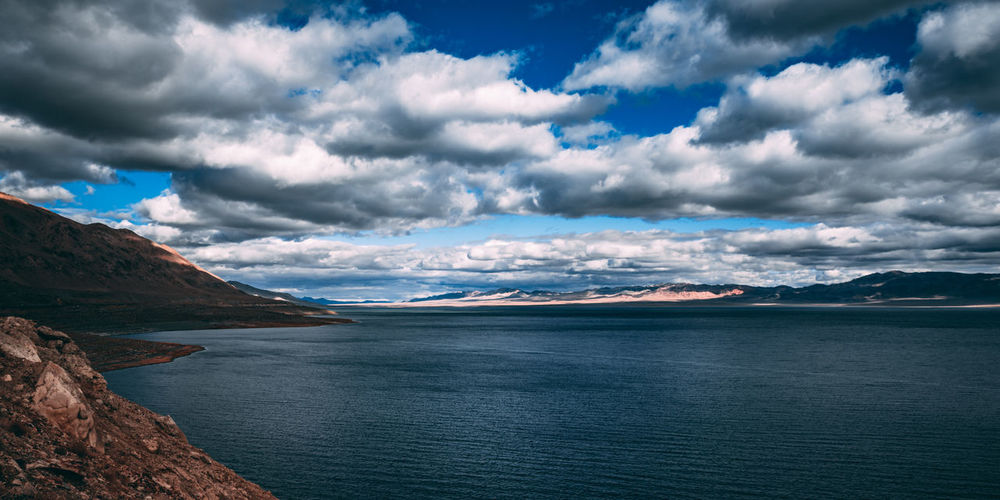 Walker Lake in Nevada with beautiful puffy clouds Landscape_Collection Beauty In Nature Cloud - Sky Clouds Day Environment Idyllic Lake Landscape Mountain Mountain Range Nature Nevada No People Non-urban Scene Ominous Outdoors Scenics - Nature Sea Sky Tranquil Scene Tranquility Walker Lake, Nv Water Waterfront