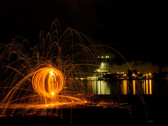 Wire Wool At Lakeshore Against Sky At Night