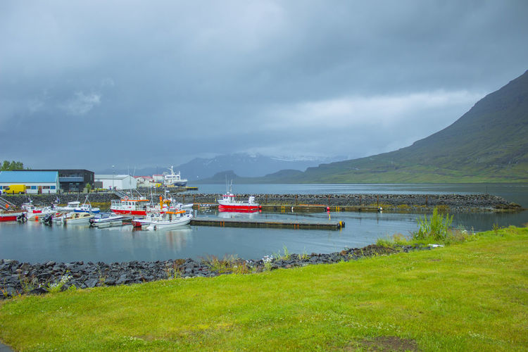 Small Harbour (Eskifjorour, Iceland) Eskifjorour Harbour Wildlands  Beauty In Nature Cloud - Sky Day Fiord Grass Iceland Trip Lake Mode Of Transport Moored Mountain Mountain Range Nature Nautical Vessel No People Outdoors Raining Day Scenics Sky Tranquil Scene Tranquility Transportation Water