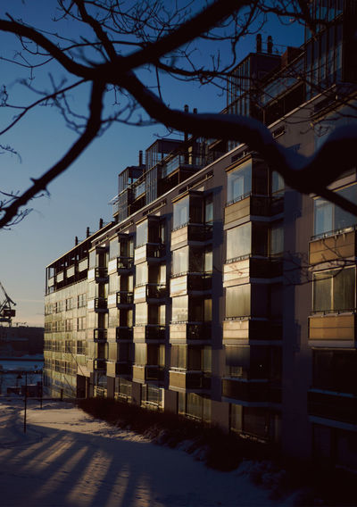 Building reflections in Sinebrychoff park Architecture Reflection Sunset City Sky Dusk Harbor Windows Industry Winter Building Snow Harbour Window Clear Sky Snowy Bare Tree Window Reflections Snowy Ground Building Exterior Residential District Built Structure Cold Temperature City Life Gh5