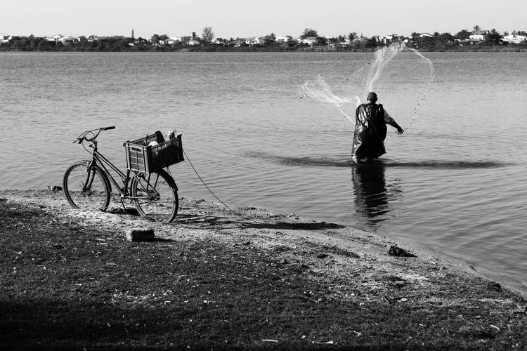 Fishing Adult Beauty In Nature Bicycle Blackandwhite Day Fishing Full Length Julhofragaphotography Leisure Activity Lifestyles Men Nature One Person Outdoors People Real People Sea Sky Standing Water