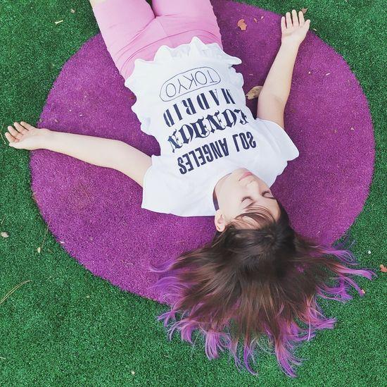 High angle view of girl lying on carpet