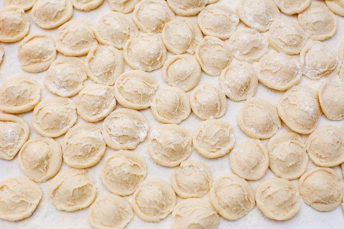 Knead orecchiette homemade Apúlia Baresi Bari Dough Flour Food Hand Handmade Hands Housework Italian Knead Kneading Knife Macaroni Making Mediterranean  Orecchiette Pasta Prepare Puglia Raw Strascinate
