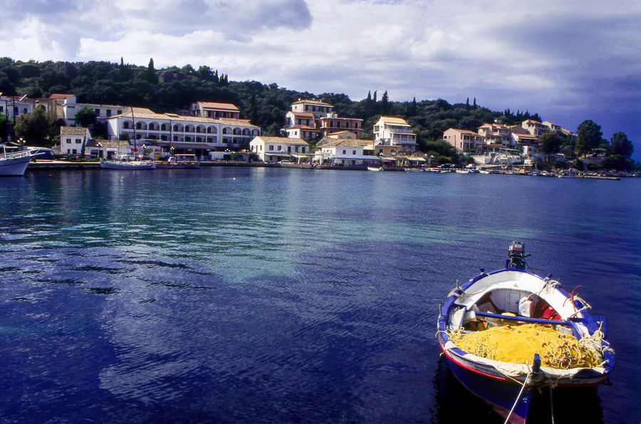 Fishing boat moored in harbour at Kassiopi, Corfu, Greece Boat Cloudy Sky Corfu, Greece Fishing Boat Greece Harbourside Ionianislands Kassiopi Kerkyra Moored Nautical Vessel No People Outdoors Picturesque Quayside Sea Travel Photography