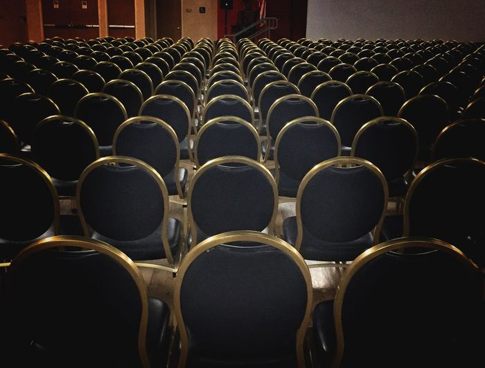 Empty Chairs At Auditorium