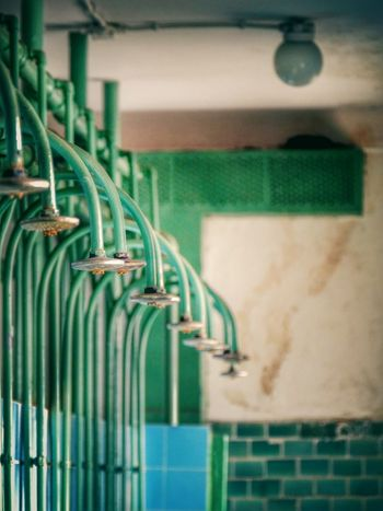 Taking Photos Abandoned Buildings Abandoned Vintage Moments Showers Green Focus On Foreground Pattern Old Indoors  EyeEm Gallery Bad Condition Once Upon A Time Perspective