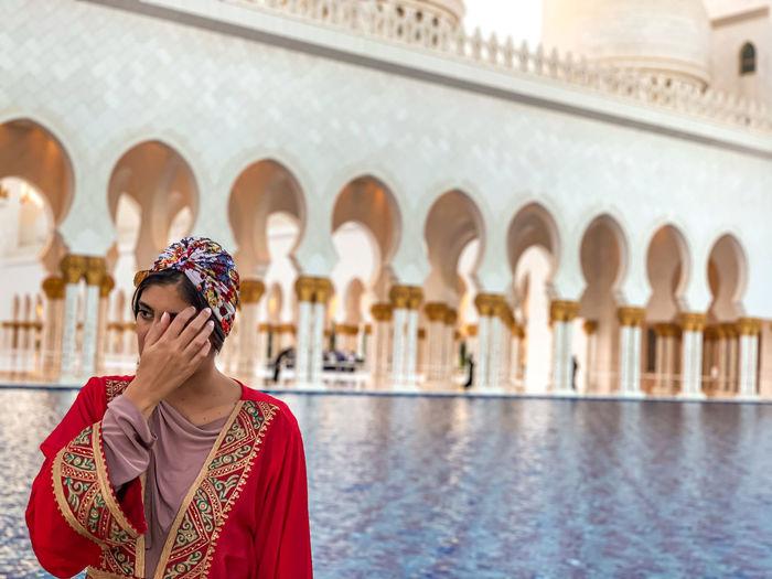 Portrait of woman against a mosque