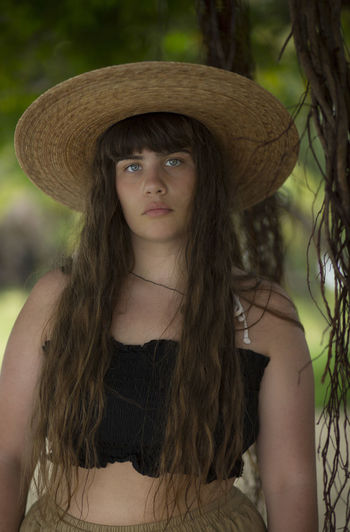 Blue Eyes Fiji Islands Hot Tropical Paradise Tropics Beautiful Woman Close-up Day Focus On Foreground Front View Hat Leisure Activity Lifestyles Looking At Camera One Person Outdoors Portrait Real People Straw Hat Summer Teenage Girls Teenager Tropical Climate Young Adult Young Women