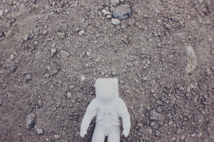 Close-up of figurine on ground