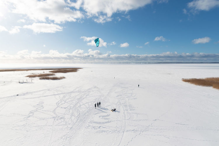 Scenic view of beach against sky during winter