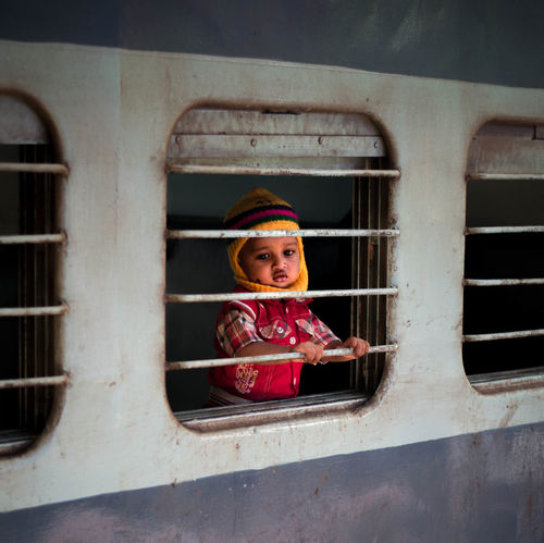 Colors India India Style Indian Culture  Life Love Nikon TravelStories Childhood Day Happiness India Love Indianstories Indiapictures Lifestyles Looking At Camera Looking Through Window Nikonphotography Photography Real People Train Trainstation Travelphotography Travelshots Window