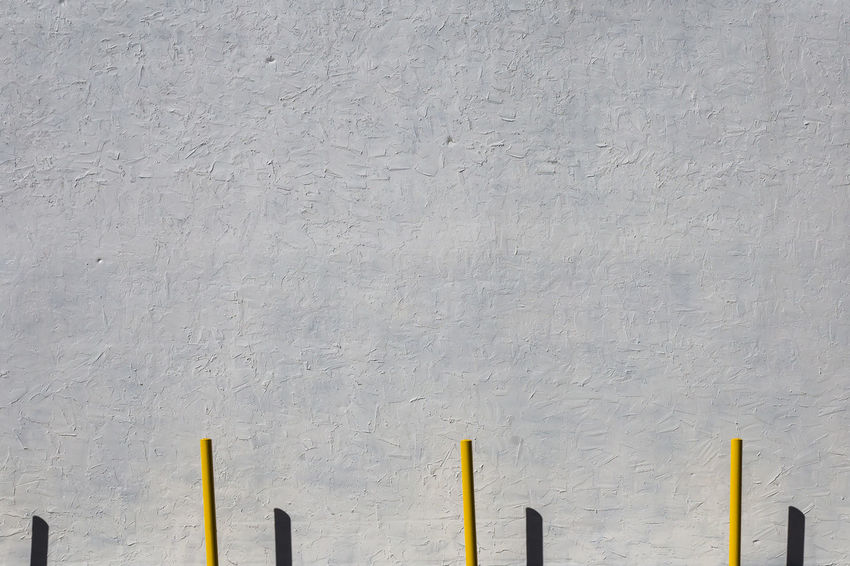 Architecture Backgrounds Building Exterior Built Structure Concrete Copy Space Day Full Frame In A Row Low Angle View Metal Minimalism No People Outdoors Pattern Side By Side Wall Wall - Building Feature White Color Wood - Material Yellow