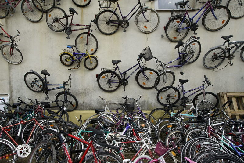 Bicycle Bicycle Rack Bicycle Shop Day Land Vehicle Large Group Of Objects Mode Of Transport No People Outdoors Repair Shop Retail  Stationary Tire Transportation Wall Art