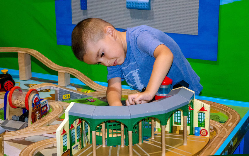 make believe is fun for this young train engenier Person Male Boy Hispanic Make Believe Pretending Child Childhood Fun Explore Train Tracks Train - Vehicle America Train Station Train Toys Playing Small Models