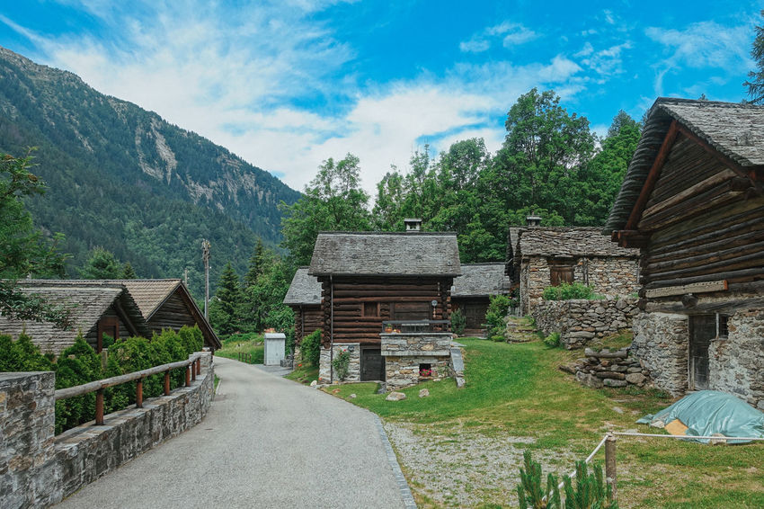 Mogno Travel Travel Photography Architecture Beauty In Nature Building Building Exterior Built Structure Cloud - Sky Cottage Day Direction Environment House Hut Landscape Mountain Nature No People Plant Sky Switzerland The Way Forward Travel Destinations Tree