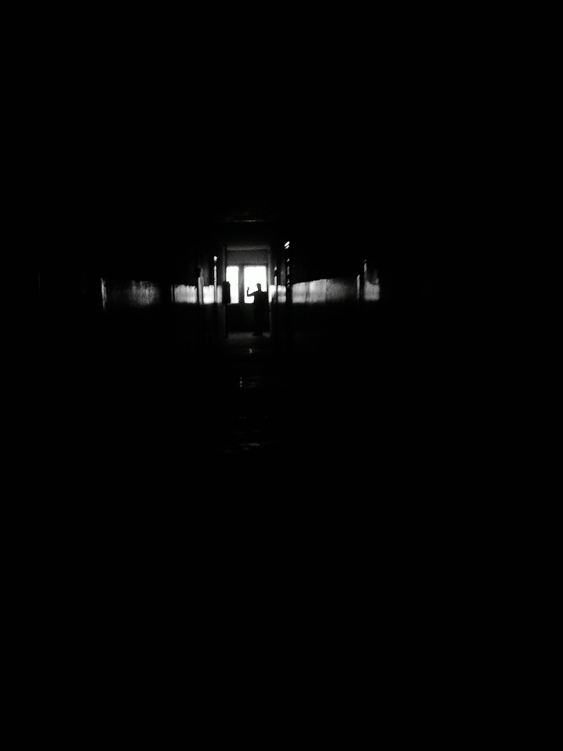 night, dark, illuminated, copy space, indoors, silhouette, built structure, architecture, empty, the way forward, lighting equipment, darkness, light - natural phenomenon, transportation, unrecognizable person, absence, light, tunnel