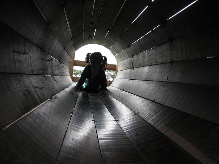 Girl in tube slide