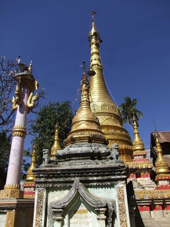 Buddhist Stupas & Ceremonial Column Blue Sky Buddhism Buddhist Culture Buddhist Pagoda Buddhist Stupas Buddhist Temple Clear Sky Composition Full Frame Gold Coloured Gold Stupas Low Angle View Myanmar No People Outdoor Photography Palm Tree Place Of Pilgrimage Place Of Prayer Place Of Worship Religion Salay Spirituality Sunlight Travel Destination Tree