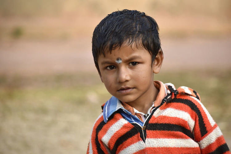 Close-up portrait of innocent boy