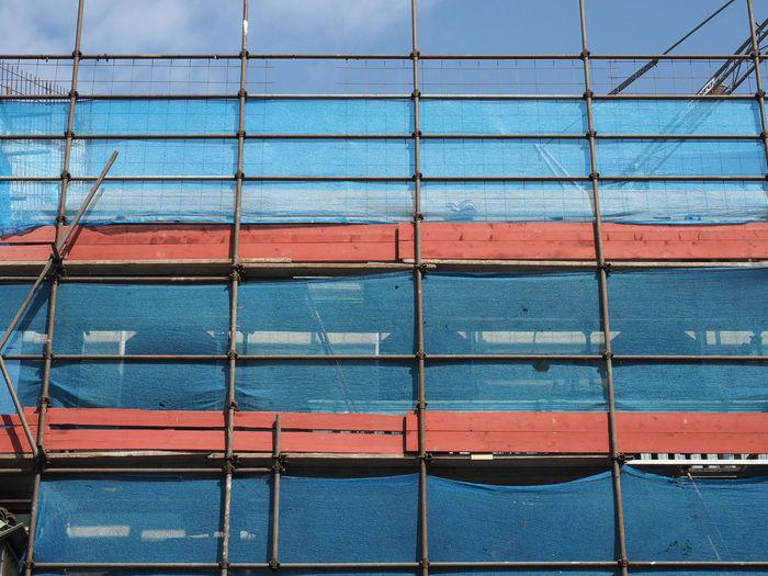 Full frame shot of building seen through window