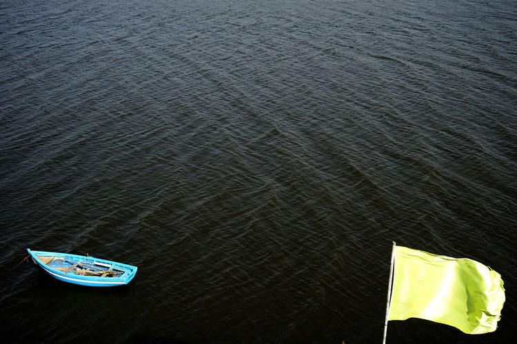 High angle view of flag on boat in sea