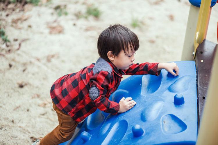 High angle view of boy playing on land