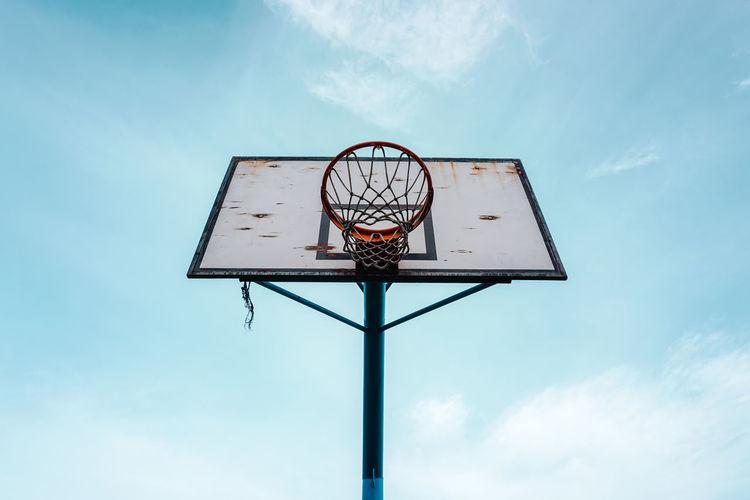 Street basketball hoop and blue sky