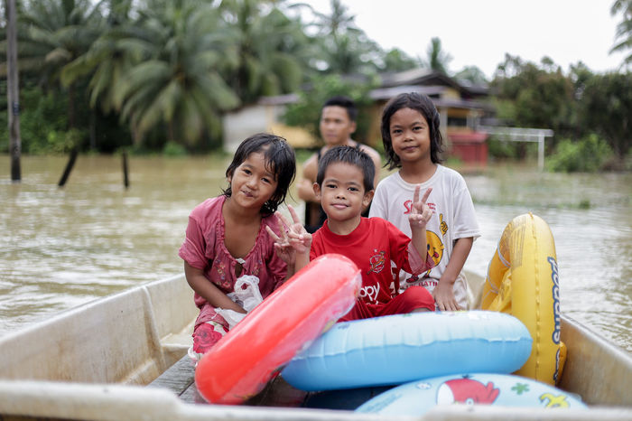 flood victims at kelantan Flood Victim Boys Childhood Day Elementary Age Family Girls Happiness Leisure Activity Lifestyles Looking At Camera Mother Nature Outdoors Portrait Real People Sitting Smiling Togetherness Tree Water Young Adult Young Women