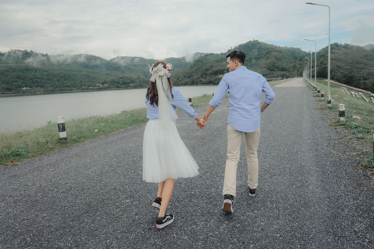 Young couple walking on road