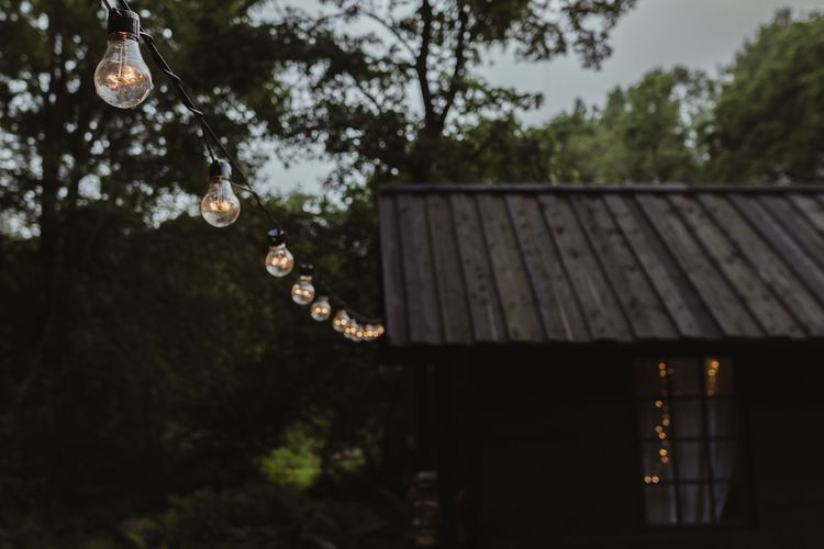 Hanging Roof Focus On Foreground No People Outdoors Tree Day Architecture Nature Close-up Lights String Lights Edison Bulb Garden Cabin Woods Breathing Space