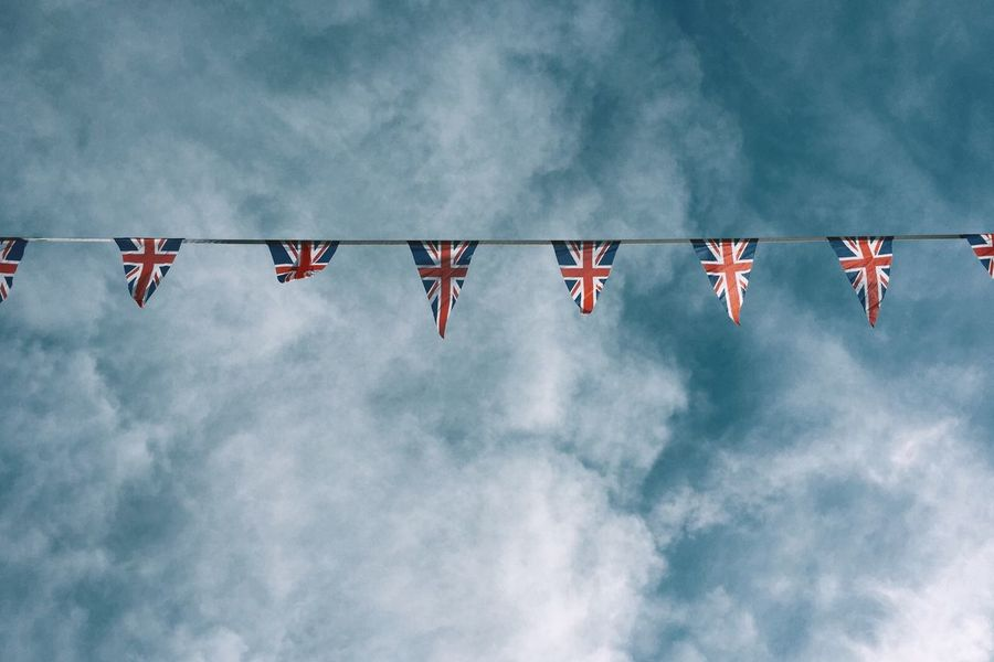 Bunting in the early morning sun. Bunting Celebration Clouds Clouds And Sky Day Flag Outdoors RNI Film App Sky Summer Union Jack