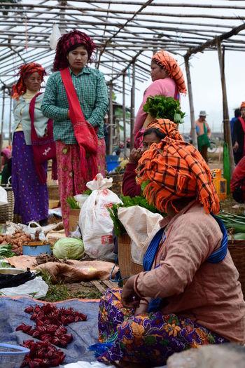 Black Karen tribe women at Thaung Tho Village market. Inle lake. Myanmar Inle Karen Tribe Adult Adults Only Black Karen Burma Burma People Ethnic Ethnic Group Food Freshness Inle Lake Inle Lake, Shan State, Myanmar Karen Women Market Mountain Myanmar Outdoors People Real People Vegetable Weekly Market Women