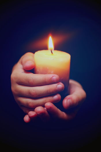 Hands and Candle Black Background Burning Candle Candlelight Child Darkness And Light Fire Fire - Natural Phenomenon Flame Glowing Hands Holding Illuminated Innocence Light And Shadow One Person Person Softness