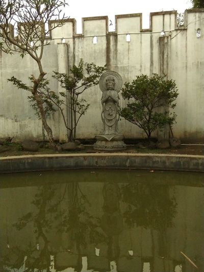 goddess statue Buddha Temple Buddha Statue Garden Stroll In The Garden Park - Man Made Space Temple PrayertoGOD Prayer Park Religion Backyard Prayertime Tree Water Flood Reflection Sky Architecture Building Exterior Built Structure Reflecting Pool Puddle