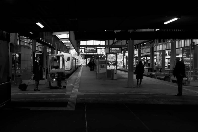 People at railroad station at night