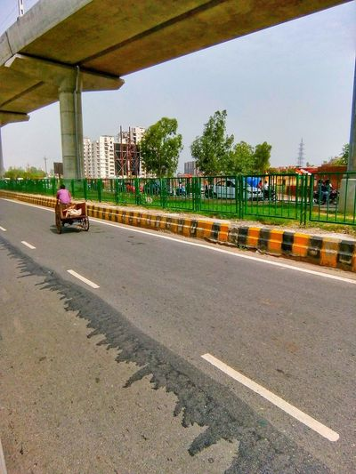 Landscape of road highway flyover Rikshaw Footpath Ghaziabad India Metro Road City Day Flyover Highway Nature Outdoors Road Sky Space Transportation Two Lane Highway Dividing Line Treelined Rickshaw Empty Road vanishing point Road Marking Multiple Lane Highway Traffic Overpass Elevated Road Double Yellow Line Asphalt 2018 In One Photograph