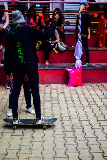 Women People Skateboarding Skateboard Helping Day Social Event  Outdoors Young Adult Cultures Real People Music Concert Sunlight Concert Photography Streetphotography