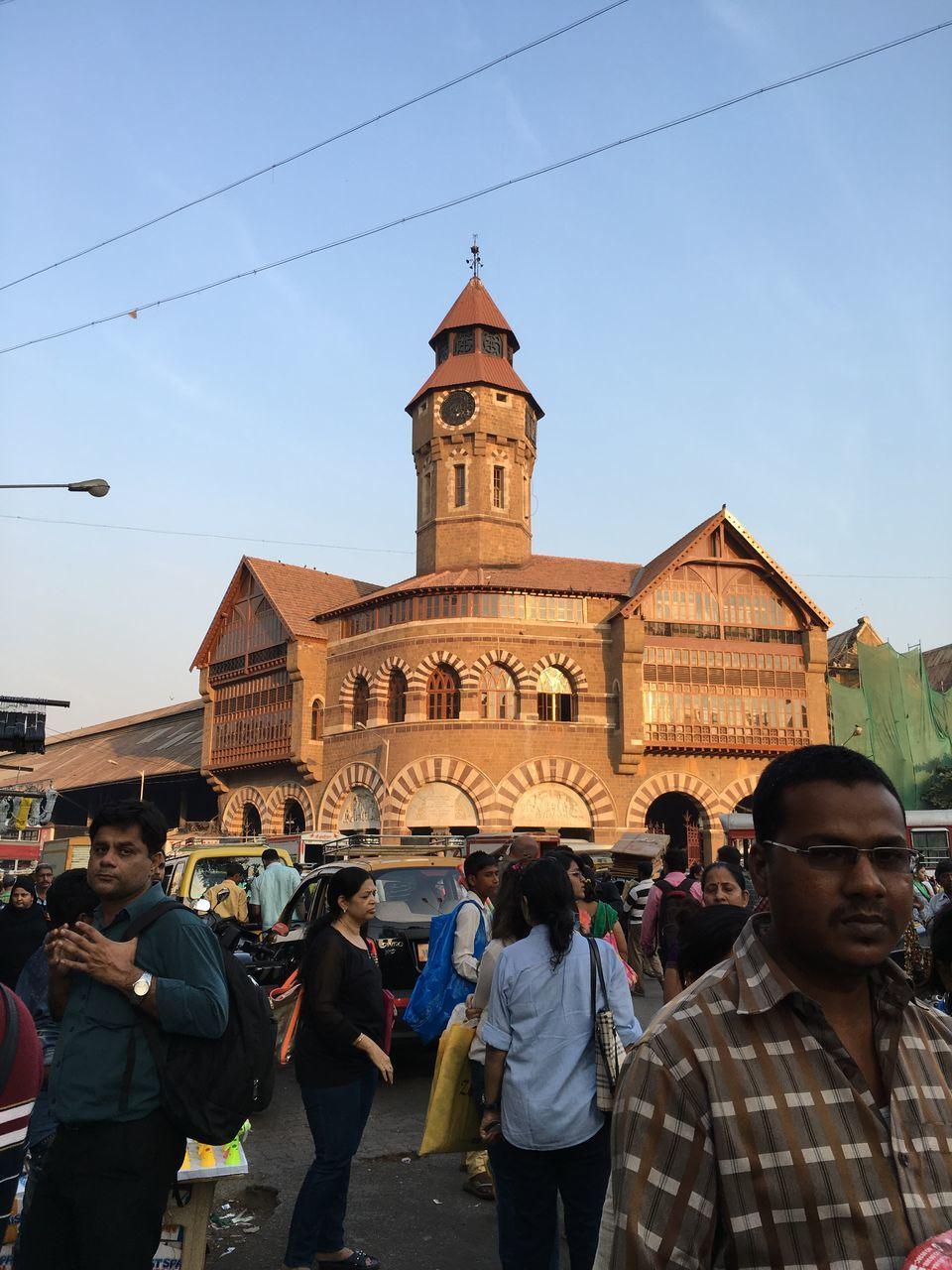 real people, large group of people, architecture, religion, building exterior, spirituality, built structure, place of worship, men, lifestyles, day, women, outdoors, sky, travel destinations, standing, togetherness, crowd, people